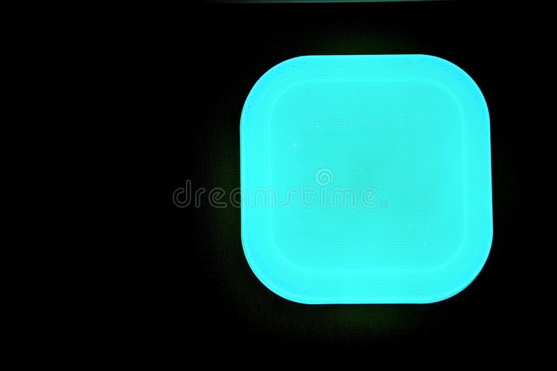 Turquoise square with beveled corners on black background. The bottom view image of the chandelier in the style modern. The bottom view image of the chandelier royalty free stock photos