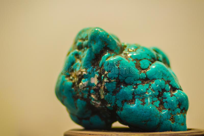 Turquoise stone specimen from mining for education. Turquoise is. An opaque, blue-to-green mineral that is a hydrated phosphate of copper and aluminium and stock image