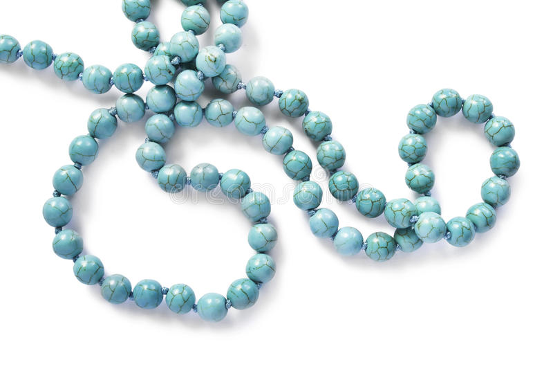 Turquoise. String of turquoise beads isolated over white royalty free stock images