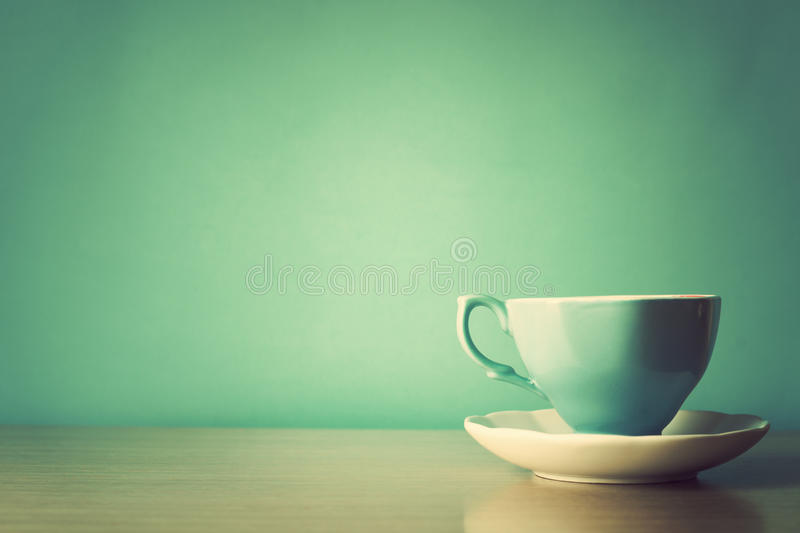 Turquoise tea cup. Over turquoise background stock image