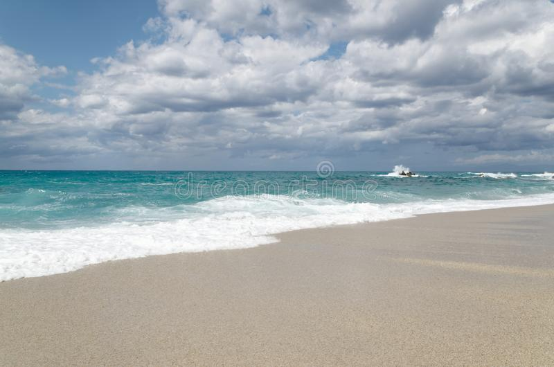 Turquoise water on the Riaci beach near Tropea, Italy. Turquoise water and cloudy sky on the Riaci beach near Tropea, Italy stock image