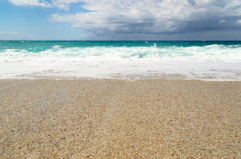 Turquoise water on the Riaci beach near Tropea, Italy. Turquoise water and cloudy sky on the Riaci beach near Tropea, Italy stock photo