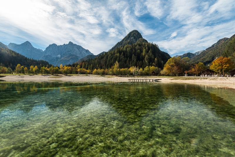 Turquoise water and colorful mountains at Jasna lake in fall,Slovenia stock images