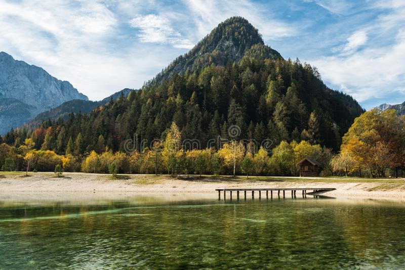 Turquoise water and colorful mountains at Jasna lake in fall,Slovenia royalty free stock photography