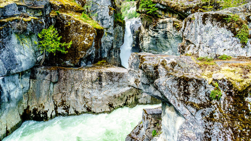 Turquoise water of the Lillooet River cascading down Nairn Falls royalty free stock images