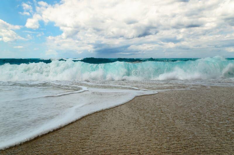 Turquoise water on the Riaci beach near Tropea, Italy. Turquoise water and cloudy sky on the Riaci beach near Tropea, Italy stock photos