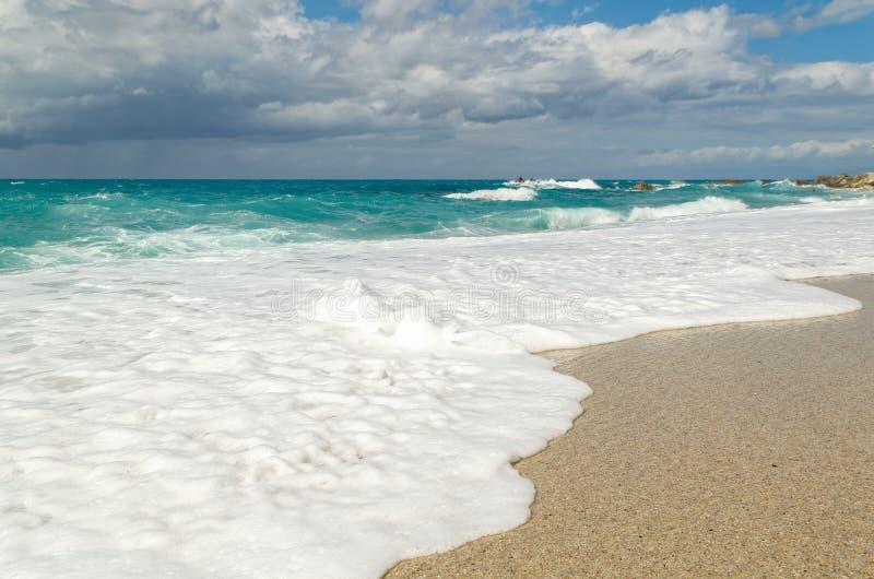 Turquoise water on the Riaci beach near Tropea, Italy. Turquoise sea and cloudy sky on the Riaci beach near Tropea, Italy royalty free stock images