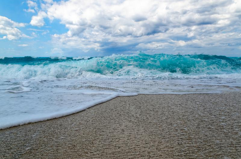 Turquoise water on the Riaci beach near Tropea, Italy. Turquoise water and the cloudy sky on the Riaci beach near Tropea, Italy royalty free stock images