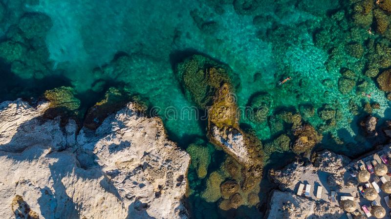 Turquoise Water and Rocky Shore on Greek Island, Aerial top Down View stock photography