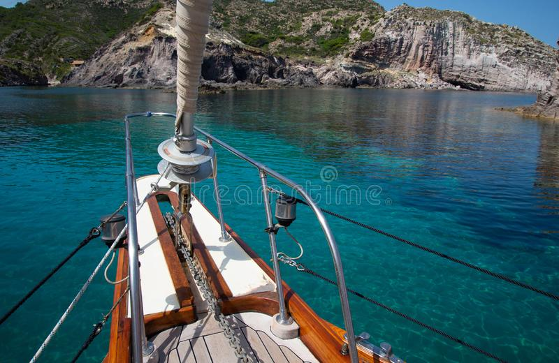 Turquoise water and sailing boat. Island of Sardinia, Italy. Sardinia, the biggest island in the Mediterranean sea. Sailing boat and turquoise azure water stock photos
