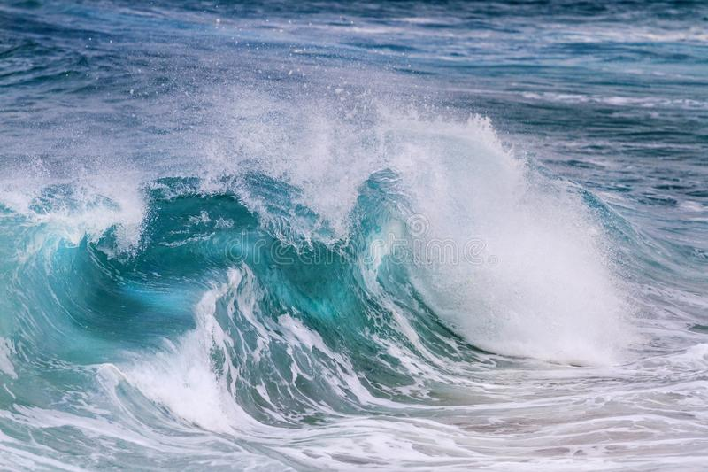 Turquoise wave is illuminated from the middle stock images