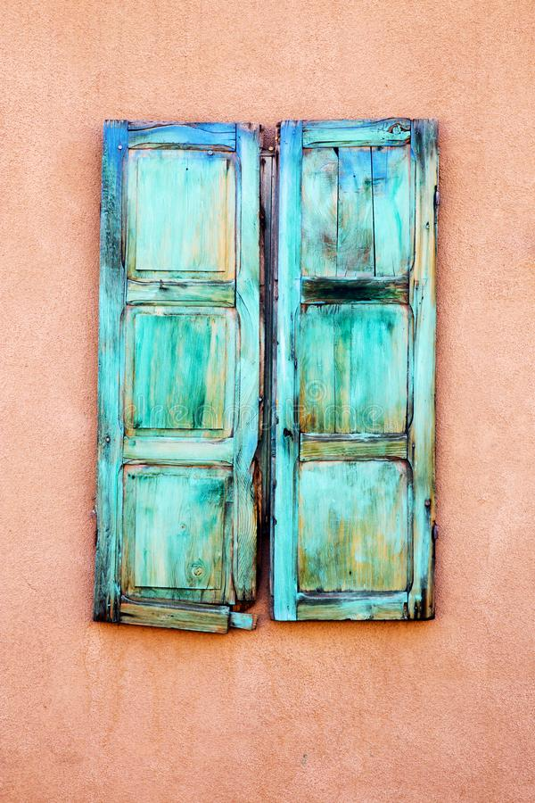 Turquoise Window Shutters in Santa Fe, New Mexico. Turquoise, Blue, Green Window Shutters in Alley Santa Fe, New Mexico royalty free stock photos