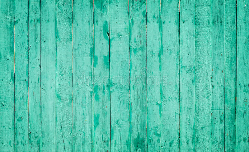 Turquoise wooden planks. Bright and saturated wooden fence royalty free stock photo