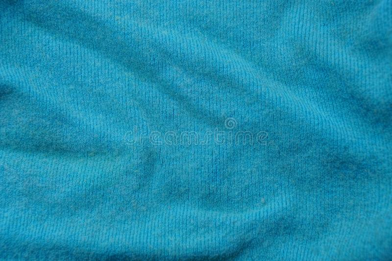 Turquoise woolen texture of crumpled old clothes. Turquoise wool background made from crumpled old clothes royalty free stock image
