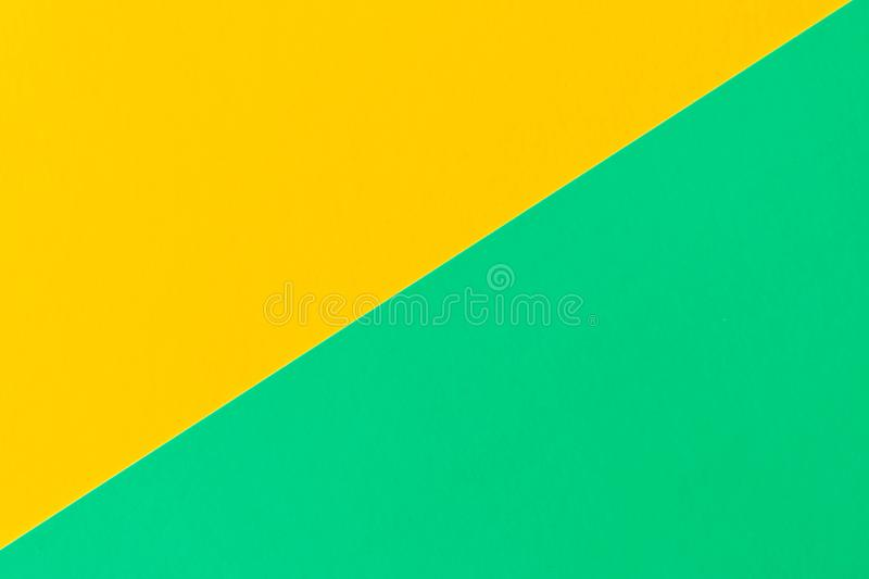 Turquoise-yellow background . Texture of colored cardboard royalty free stock images