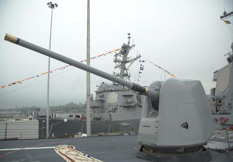 Turret containing a 5-inch gun on the deck of US Navy guided-missile destroyer USS McFaul during Fleet Week 2014. NEW YORK - MAY 22: Turret containing a 5-inch stock photo