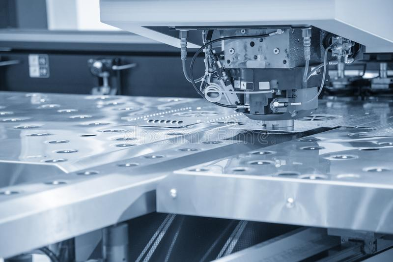 Turret punching machine cutting the metal  plate. Metal forming machine stock photos