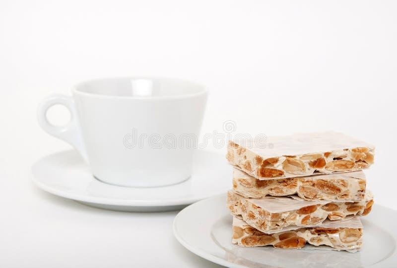turron för spansk teacup för efterrätt traditionell arkivbilder