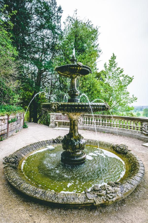 Turtle Fountain on Viewpoint English Countryside Landscape. Historic Turtle Fountain on Viewpoint surrounded by foliage and trees. View of an English Countryside royalty free stock image