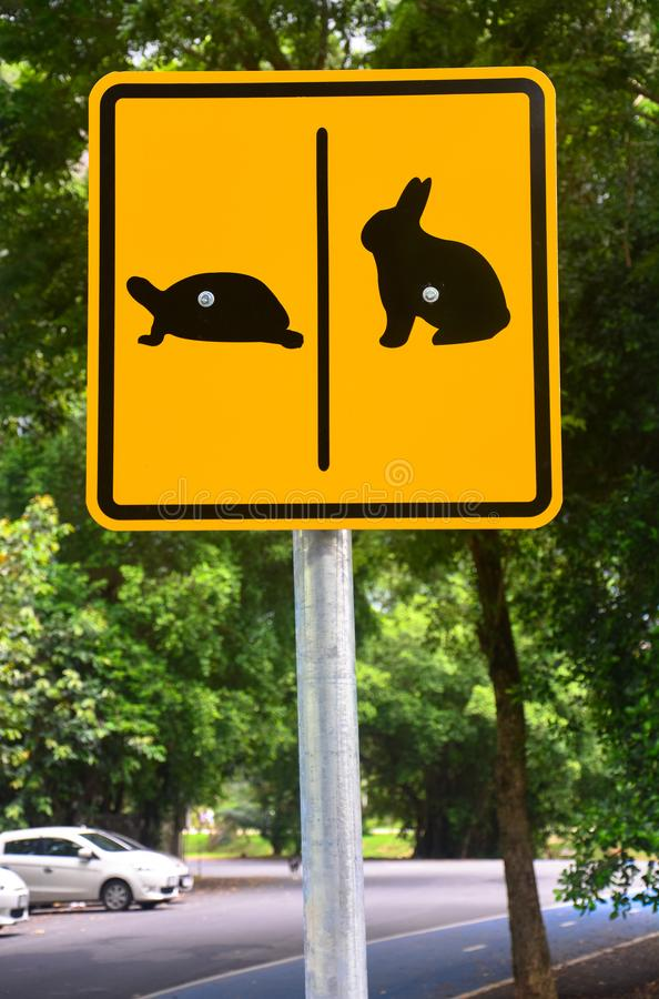 Turtle and rabbit sign in public park stock photography