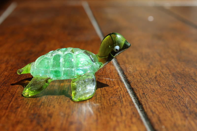 Turtle Ready for the Race. Small glass turtle lined up ready to run a race royalty free stock images