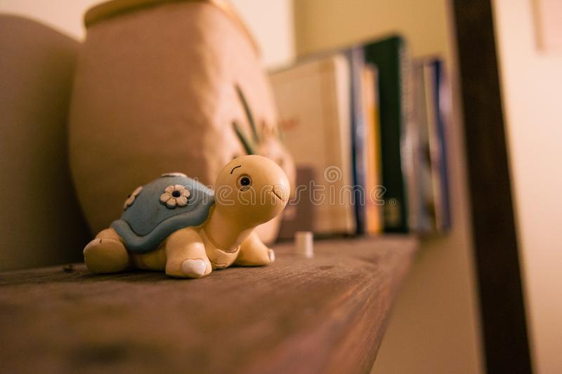 Turtle toy on shelf royalty free stock images
