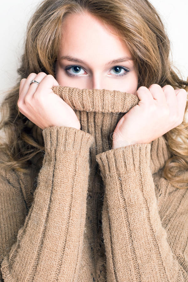 Turtleneck hide and seek. stock photos