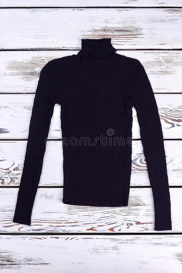 Turtleneck woolen sweater for boys. Black turtleneck knitted sweater for casual wear, top view. Children woolen winter apparel royalty free stock photos