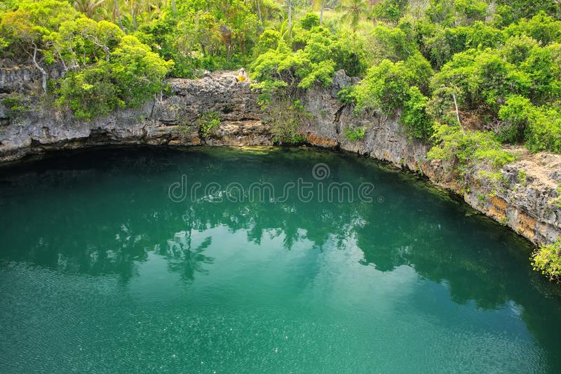 Turtles Hole in the north of Ouvea Island, Loyalty Islands, New Caledonia. This hole is connected undeground to the sea royalty free stock images