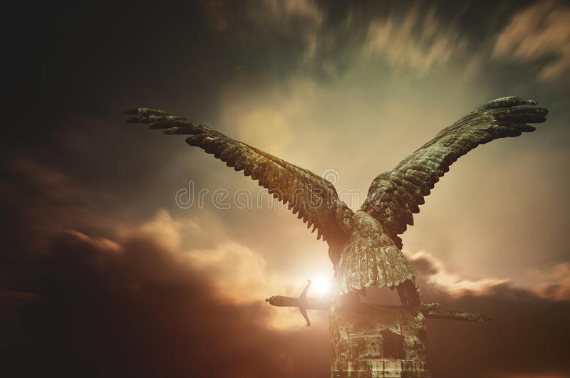 Turul bird with a sword with apocalyptic sky. In the Royal Castle, Budapest, Hungary stock images