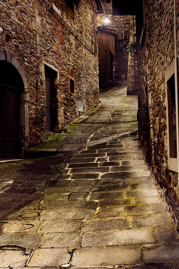 Tuscan alley at night stock images