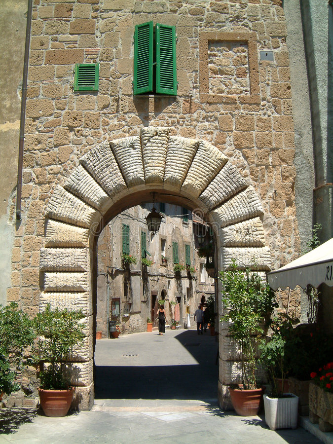 Tuscan archway. In town wall royalty free stock images