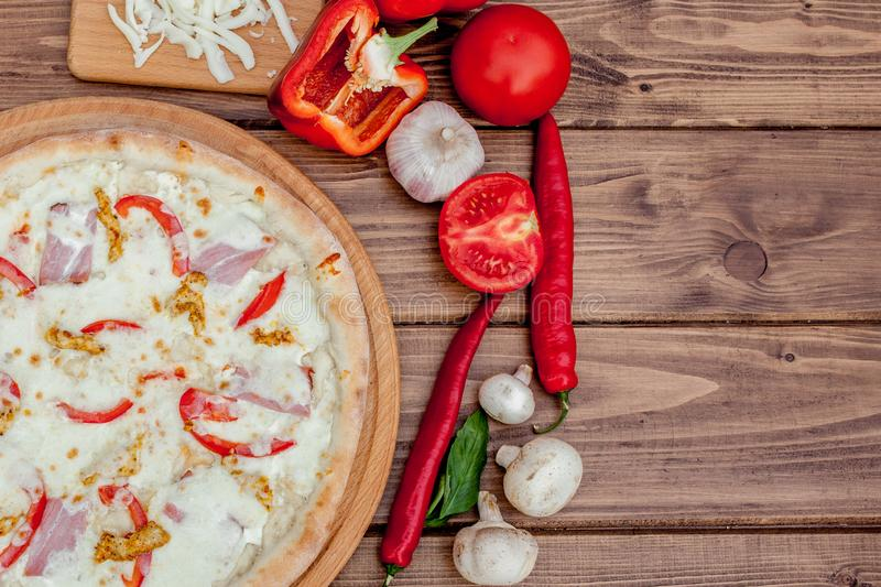 Tuscan Classic Pizza on the wooden table, top view. Vegetarian food royalty free stock photography