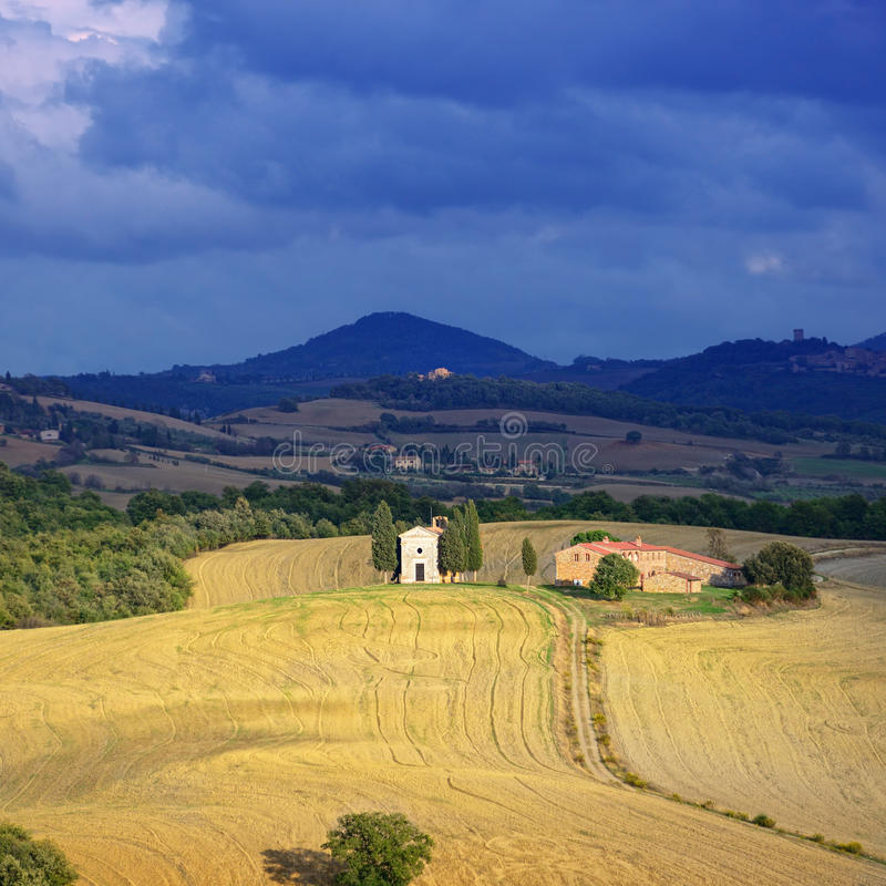 Tuscan landscape. Idyllic Tuscan landscape at sunset near Pienza, Vall d'Orcia Italy, Europe. View on Church of Capella De Vitaleta royalty free stock photography