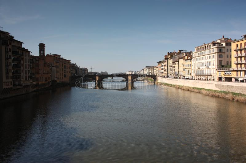 Tuscan middle bridge on the Florence canal on an Italian spring day stock image