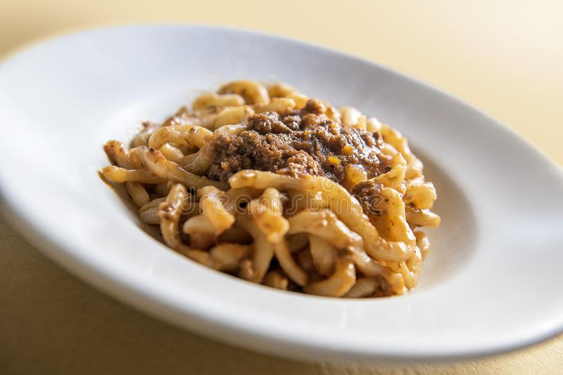 Tuscan pici pasta dish with meat sauce stock photo
