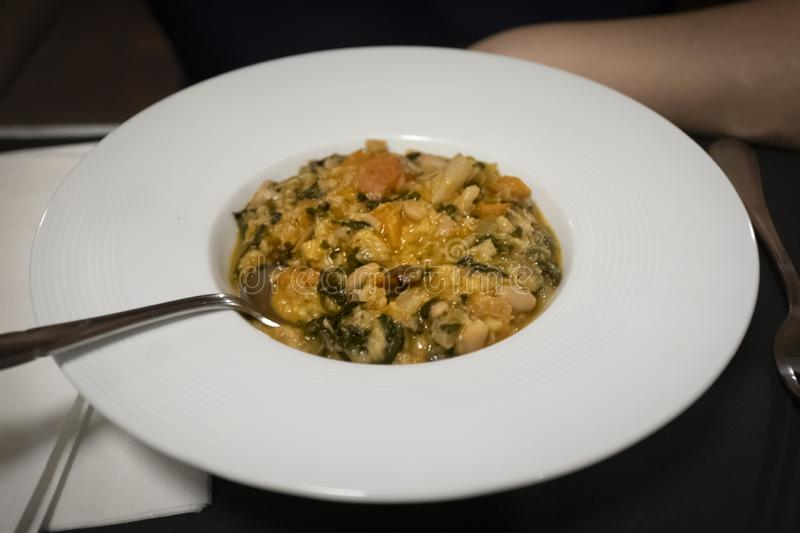 Tuscan ribollita, typical rustic Tuscan soup served in a deep dish. Ribollita or Minestra di Pane is a famous Tuscan bread soup, a hearty potage made with royalty free stock photo