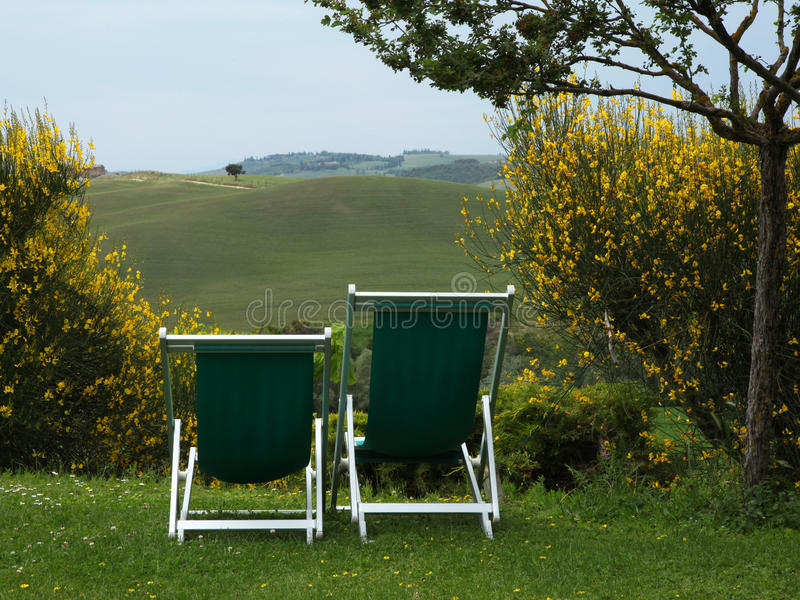 Tuscan view with two chairs in the foreground royalty free stock photo