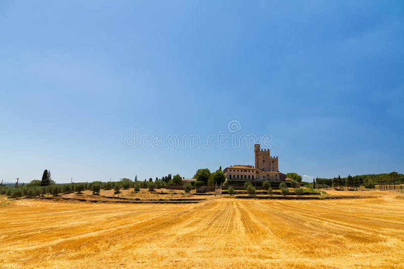 Tuscan Villa. An old big country house surrounded by golden fields in Tuscany, Italy royalty free stock photos