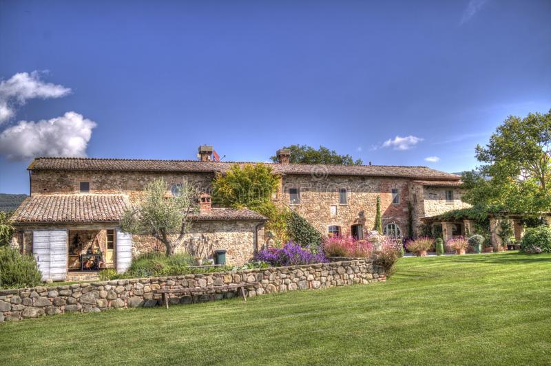 Tuscan villa resort. A typical tuscan country cottage, made with red bicks and with a nice park around it in a sunny, bright day royalty free stock images