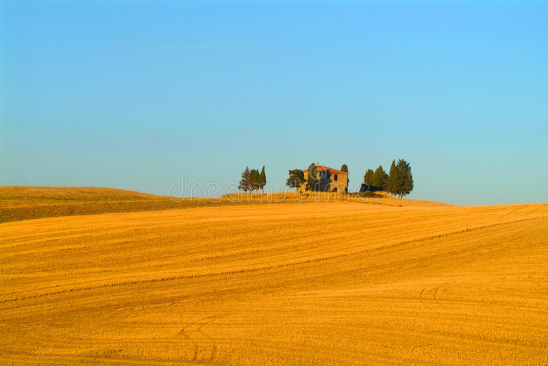 Tuscany. Yellow cottage on a hill stock photo
