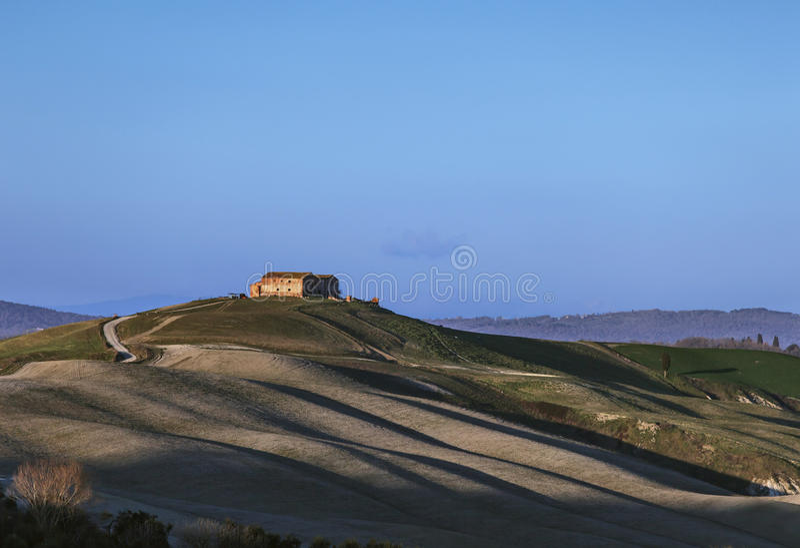 Tuscany, Crete Senesi old farmland and rolling hills on sunset. royalty free stock photography
