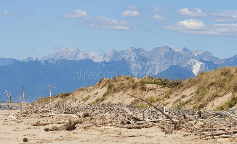 Tuscany deserted sand beach and mountains landscape royalty free stock photos