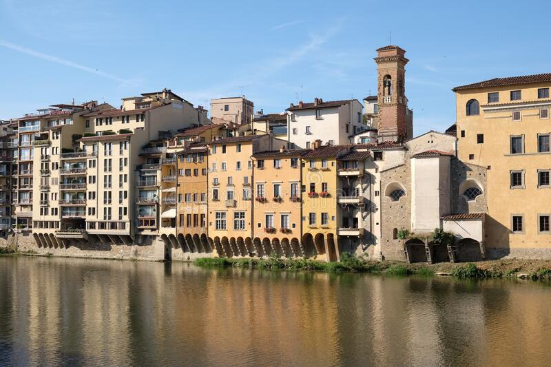 On Arno river there is a line colourful buildings. The place is Florence, Tuscany in Italy. The river reflects the facades of the ancient houses stock images