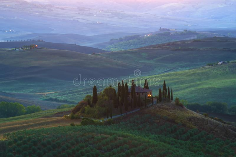 The old villa `Podere Belvedere` in the sunrise landscape, Tuscany. TUSCANY, ITALY - SEPTEMBER 21, 2017: The old villa `Podere Belvedere` in the sunrise stock images