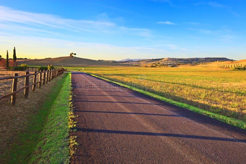 Tuscany, Maremma sunset landscape. Rural road. stock photography