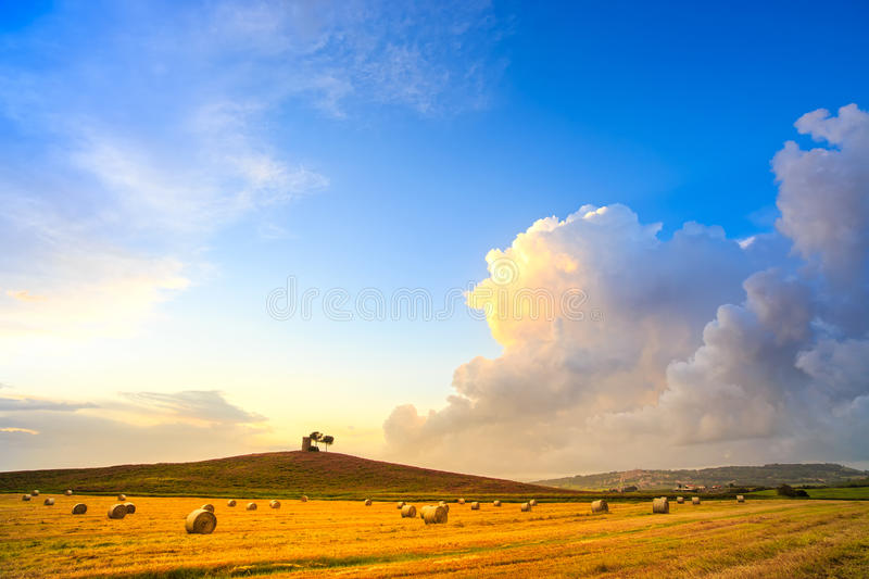 Tuscany, Maremma sunset landscape and thunderstorm cloud. Rural royalty free stock images