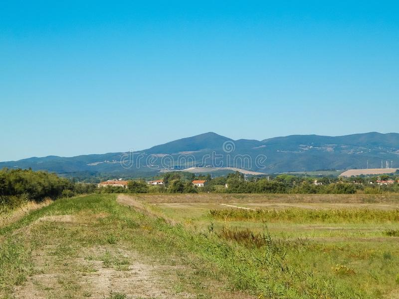 Tuscany, view of meadow and Apennines in the background. Summer in Tuscany, Italy royalty free stock photography