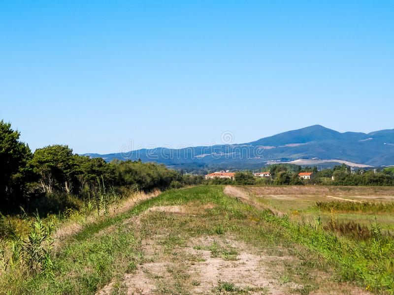 Tuscany, view of meadow and Apennines in the background. Summer in Tuscany, Italy stock photos