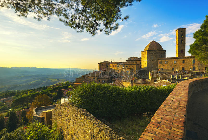 Tuscany, Volterra town skyline, church and trees on sunset. Ital royalty free stock photography